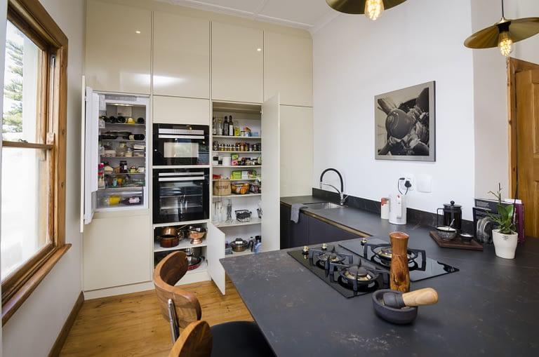 Kitchen with storage & pantry.